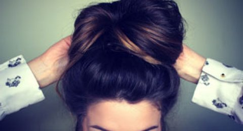 Style tip: Try retro side swept bun